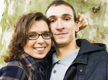 Love couple. Love smiling couple against tree background Royalty Free Stock Images