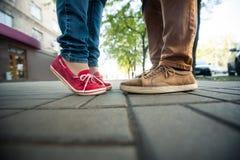 Love couple standing on the sidewalk Stock Photos