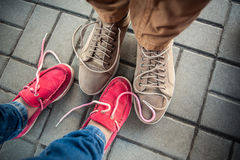 Love couple standing on the sidewalk Royalty Free Stock Photography