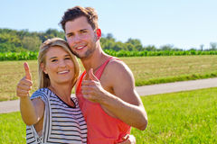 Love couple in summer with thumb up Royalty Free Stock Photos