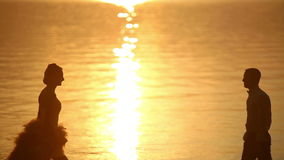 Love couple at sunset stock footage