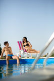 Love couple by swimming pool Royalty Free Stock Image