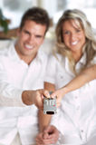 Love couple with TV remote control Royalty Free Stock Image