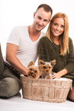 Love Couple with two yorkshire terrier in basket  - autumn fashion Royalty Free Stock Images