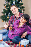 Love couple under christmas tree with wine Royalty Free Stock Photo