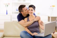 Love couple using laptop computer Stock Photos