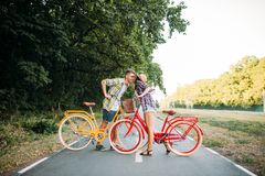 Love couple with vintage bicycle walking in park Royalty Free Stock Image