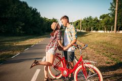 Love couple with vintage bicycle walking in park Stock Photos
