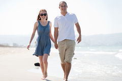 Love couple walk on the beach. Happy young couple walk at the beach royalty free stock image