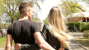 In love couple walking in park. Inlove couple walking in park. Happiness and relationship. Young inlove couple stock footage