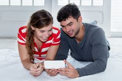 Love couple watching movie on mobile phone Stock Photo