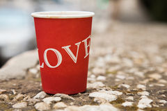 Love in a cup. Paper cup on a stone wall in madaba, jordan royalty free stock image