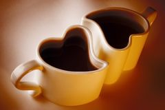 Love cups of coffee. Two love cups of coffee for valentines day Stock Photos