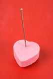 Love Curse. Pink Heart Shape Candy and pin, concept of Love Curse Royalty Free Stock Photo