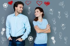Romantic young couple looking at each other and kindly smiling. Love. Cute smiling couple standing near and kindly looking at each other Royalty Free Stock Image