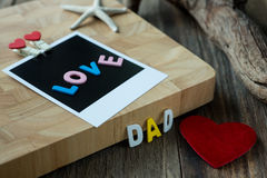 Love Dad message on Blank instant photo Royalty Free Stock Photo