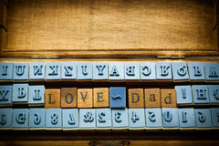 Love dad spelling with rubber stamp Stock Photo