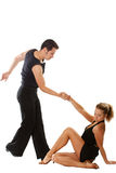 Love dancing. The young woman and the man dancing the American dance Royalty Free Stock Photo