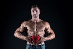 Love date. bodybuilder man share his heart. i lay my love on you. valentines day. Valentines day sales. World heart day. I will be your Valentine. sexy macho royalty free stock photo