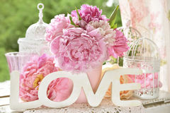 Love decoration with wooden letters and peony flowers with color Royalty Free Stock Images