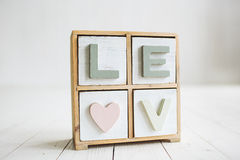 Love decorative letters on the white wooden background Stock Photo