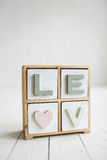 Love decorative letters on the white wooden background Royalty Free Stock Images