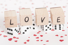 Love and Dice on Heart Background. Stock Photography