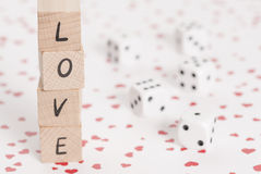 Love and Dice on Heart Background. Royalty Free Stock Photo