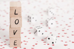 Love and Dice on Heart Background. Stock Photo