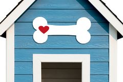 Love Dog Concept. Dog House. Love Dog Concept. White bone with red heart shape in front of Dog House royalty free stock photo