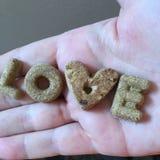 Dog treats. Love dog treats puppy dogs alphabet heart stock photos
