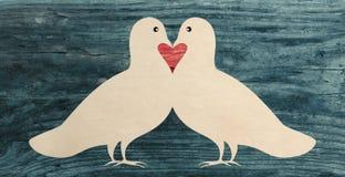 Love dove pigeon bird paper cut silhouette. Vintage Stock Images