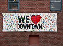 We Love Downtown Sign on Brick Wall Stock Photos