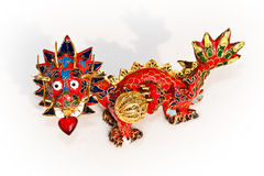 Love of a dragon. Dragons love. Close-up of Chinese enameled dragon on white snow, with heart in mouth Royalty Free Stock Photography