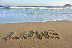 Love drawn on the beach Stock Images