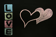 Love drawn in chalk on a chalkboard Stock Photo