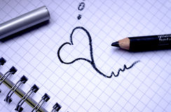 Love dreams. The small heart drawn in a notebook by a pencil Royalty Free Stock Photo