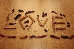 Love dried spices. Dried spices arranged to spell the word love Royalty Free Stock Photography