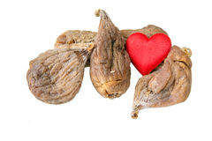 Love Dry organic figs. Few dry figs and a heart on the white background Royalty Free Stock Photography