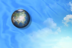 Love the earth. The earth on top of satin merge with cloud background Stock Images