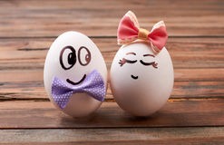 Love egg couple with bows. Drawn faces on eggs. How to make romantic breakfast stock photo