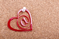 Love email heart. Red love email heart with white thumbtack on a cork-board stock images