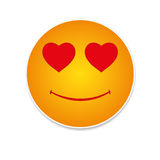 Love emoticon. Flat smile in love emoticon  on white background Royalty Free Stock Photos