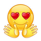 In love emoticon with open hands. Royalty Free Stock Photos