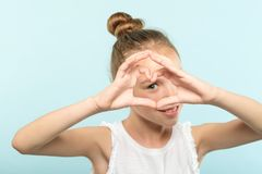 Love emotion smiling girl looking heart shape hand stock images
