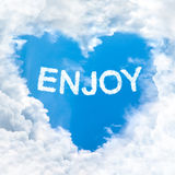 Love enjoy word on blue sky Royalty Free Stock Photo