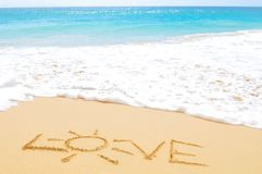 Love on an exotic beach stock image