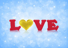 Love and fabric gold heart on blue bokeh Royalty Free Stock Image