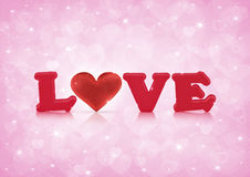 Love and fabric red heart on pink heart bokeh Royalty Free Stock Photos