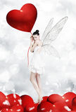 Love fairy. Atractive brunette as  with heart balloon stock photography